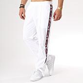 /achat-pantalons-joggings/champion-pantalon-jogging-bandes-brodees-211855-blanc-136359.html