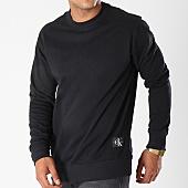 /achat-sweats-col-rond-crewneck/calvin-klein-sweat-crewneck-monogram-chest-logo-7743-noir-144091.html