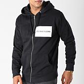 /achat-sweats-zippes-capuche/calvin-klein-sweat-zippe-capuche-institutional-logo-zip-7760-noir-144096.html