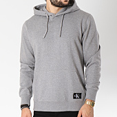 /achat-sweats-capuche/calvin-klein-sweat-capuche-monogram-logo-badge-7950-gris-chine-145113.html