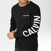 /achat-t-shirts-manches-longues/calvin-klein-tee-shirt-manches-longues--institutional-back-print-0404-noir-blanc-160247.html