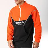 /achat-sweats-col-zippe/reebok-sweat-col-zippe-cover-up-dx0138-noir-orange-162465.html
