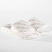 /achat-claquettes-sandales/guess-claquettes-femme-fl6savrub19-white-gold-163940.html