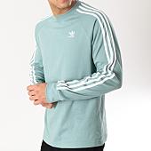 /achat-t-shirts-manches-longues/adidas-tee-shirt-manches-longues-3-stripes-dv1557-bleu-turquoise-blanc-164444.html