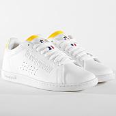 /achat-baskets-basses/le-coq-sportif-baskets-courtset-sport-1910032-optical-white-empire-yellow-165427.html