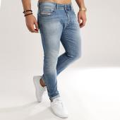 /achat-jeans/diesel-jean-slim-carrot-tepphar-00ckrh-0842h-bleu-denim-125005.html
