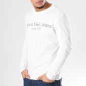 /achat-t-shirts-manches-longues/calvin-klein-tee-shirt-manches-longues-treavik-2-blanc-128314.html