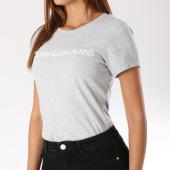 https://www.laboutiqueofficielle.com/achat-t-shirts/calvin-klein-tee-shirt-femme-7879-gris-chine-144120.html