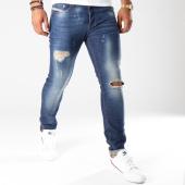 /achat-jeans/diesel-jean-slim-carrot-tepphar-00ckrh-084tx-bleu-brut-144339.html