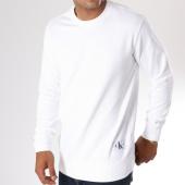 /achat-sweats-col-rond-crewneck/calvin-klein-sweat-crewneck-monogram-chest-logo-7743-blanc-146774.html