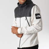 /achat-coupe-vent/the-north-face-coupe-vent-1990-mountain-ecru-gris-anthracite-146989.html