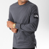 /achat-t-shirts-manches-longues/the-north-face-tee-shirt-manches-longues-fine-2-gris-anthracite-147028.html