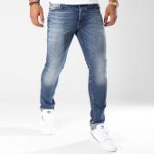 /achat-jeans/diesel-jean-slim-carrot-tepphar-00ckrh-084zx-bleu-denim-147665.html
