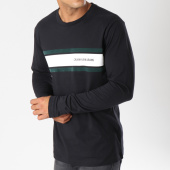 /achat-t-shirts-manches-longues/calvin-klein-tee-shirt-manches-longues-stripe-9586-noir-147938.html