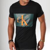 /achat-t-shirts/calvin-klein-tee-shirt-monogram-box-logo-7843-noir-vert-orange-152098.html