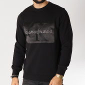 /achat-sweats-col-rond-crewneck/calvin-klein-sweat-crewneck-outlined-monogram-9527-noir-155271.html