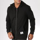 /achat-sweats-zippes-capuche/calvin-klein-sweat-zippe-capuche-nm1557e-noir-156647.html