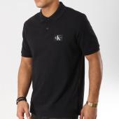 /achat-polos-manches-courtes/calvin-klein-polo-manches-courtes-monogram-logo-9467-noir-160215.html