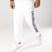 /achat-pantalons-joggings/calvin-klein-pantalon-jogging-institutional-side-logo-0451-blanc-160817.html