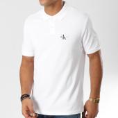 /achat-polos-manches-courtes/calvin-klein-polo-manches-courtes-monogram-logo-9467-blanc-160949.html