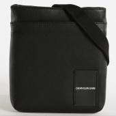 /achat-sacs-sacoches/calvin-klein-sacoche-coated-canvas-micro-flat-0814-noir-162283.html