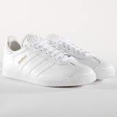 /achat-baskets-basses/adidas-baskets-gazelle-bb5498-footwear-white-gold-metallic-162574.html