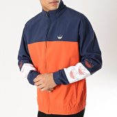 /achat-coupe-vent/adidas-coupe-vent-blocked-warm-up-dv3117-orange-bleu-marine-166138.html