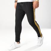 /achat-pantalons-carreaux/gianni-kavanagh-pantalon-avec-bandes-gk-noir-dore-170864.html