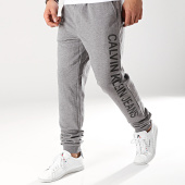 /achat-pantalons-joggings/calvin-klein-pantalon-jogging-institutionnal-side-1132-gris-chine-171294.html