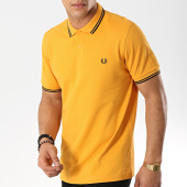 /achat-polos-manches-courtes/fred-perry-polo-manches-courtes-twin-tipped-m3600-moutarde-noir-173634.html