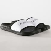 /achat-claquettes-sandales/calvin-klein-claquettes-slide-377-noir-blanc-178043.html