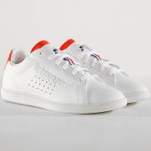 /achat-baskets-basses/le-coq-sportif-baskets-femme-courtset-gs-sport-1910312-optical-white-orange-180757.html