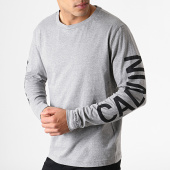 /achat-t-shirts-manches-longues/calvin-klein-tee-shirt-manches-longues-institutional-back-print-0404-gris-chine-noir-181521.html