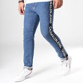 /achat-jeans/calvin-klein-jean-slim-avec-bandes-026-2784-bleu-denim-183438.html