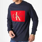 /achat-sweats-col-rond-crewneck/calvin-klein-sweat-crewneck-flock-monogram-3567-bleu-marine-rouge-183466.html