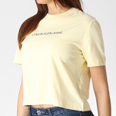 /achat-t-shirts/calvin-klein-tee-shirt-femme-crop-shrunken-institutional-1495-jaune-184103.html