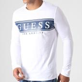 /achat-t-shirts-manches-longues/guess-tee-shirt-slim-manches-longues-m93i50k8hm0-blanc-bleu-marine-184685.html