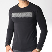 /achat-t-shirts-manches-longues/guess-tee-shirt-manches-longues-m93i40-j1300-noir-argente-185498.html