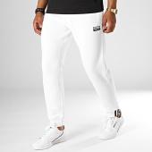 /achat-pantalons-joggings/adidas--pantalon-jogging-ryv-eh6028-blanc-casse-186490.html