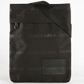 /achat-sacs-sacoches/calvin-klein-sacoche-essential-flatpack-4963-noir-187214.html