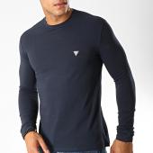 /achat-t-shirts-manches-longues/guess-tee-shirt-manches-longues-m94i34-j1300-bleu-marine-188870.html