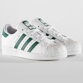 https://www.laboutiqueofficielle.com/achat-baskets-basses/adidas-baskets-femme-superstar-j-ee7821-footwear-white-collegiate-green-192435.html