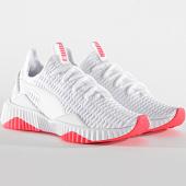 https://www.laboutiqueofficielle.com/achat-baskets-basses/puma-baskets-femme-defy-190949-puma-white-pink-alert-196008.html
