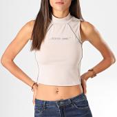 https://www.laboutiqueofficielle.com/achat-t-shirts/sixth-june-haut-femme-sans-manches-w3932vto-beige-reflechissant-196889.html