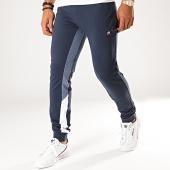 /achat-pantalons-joggings/le-coq-sportif-pantalon-jogging-slim-a-bandes-tricolore-saison-n1-1920490-bleu-marine-199513.html