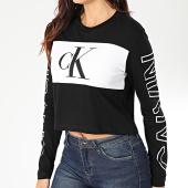https://www.laboutiqueofficielle.com/achat-t-shirts-manches-longues/calvin-klein-tee-shirt-crop-femme-manches-longues-blocking-statement-logo-3125-noir-blanc-203486.html