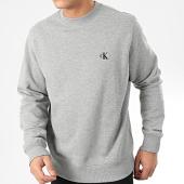 /achat-sweats-col-rond-crewneck/calvin-klein-sweat-crewneck-ck-essential-4536-gris-chine-203725.html
