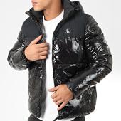 /achat-doudounes/calvin-klein-jeans-doudoune-capuche-high-shine-4075-noir-203921.html