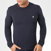 /achat-t-shirts-manches-longues/guess-tee-shirt-slim-manches-longues-m01i34-j1300-bleu-marine-204279.html