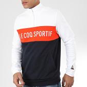 /achat-sweats-col-zippe/le-coq-sportif-sweat-col-zippe-saison-n1-2010431-blanc-bleu-marine-orange-204424.html